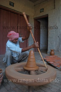 Spinning the potter's wheel with a stick