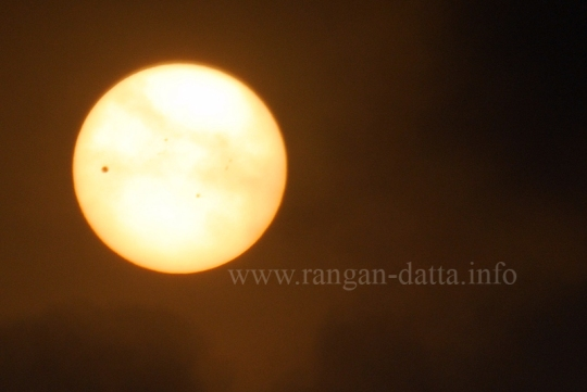 Transit of Venus (The tiny black spot on the 9 'O clock position of the solar disc is Venus). Shot just after sunrise from Calcutta