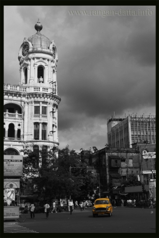 Metropolitan Building, Calcutta (Kolkata), with the yellow Ambassador Taxi