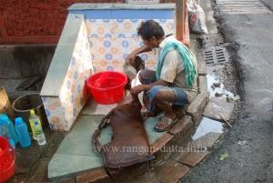 Bhisti fills his Masak, Bow Baracks, Calcutta (Kolkata)