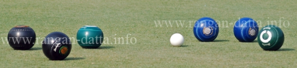 Jack (small white ball) and the woods (coloured big ball) of Lawn Bowls