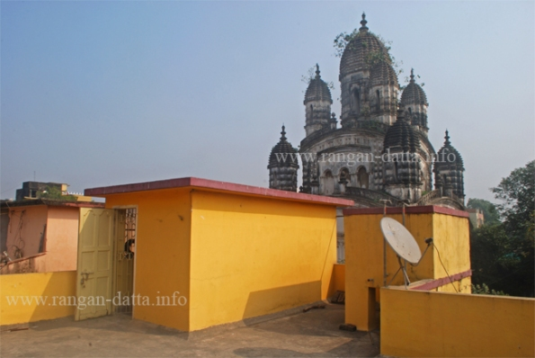 Radhanath Temple of the Mondal Family, towers above the roof top