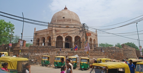 Adam Khan's Tomb towers above the Mehrauli Bus Terminus in South Delhi