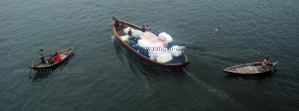 Smaller boats make way for larger boats, Buriganga, Dhaka, Bangladesh
