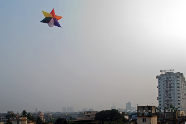 A star shaped fanush above the Belgachia (Milk Colony) skyline in North Kolkata