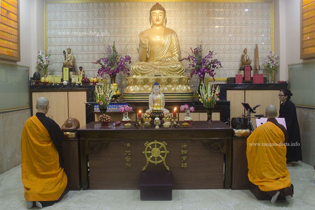 Two nuns in front of the giant Buddha statue, on the occasion of Buddha Purnima, at Fo Guang Shan Monastery, Tangra, Kolkata