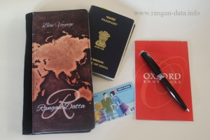 Perfico passport holder with passport, credit card, pen and writing pad