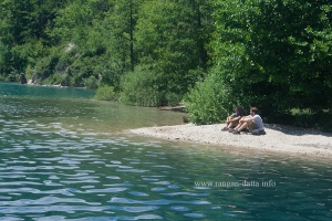Tourist relax on the banks of Plitvice Lakes