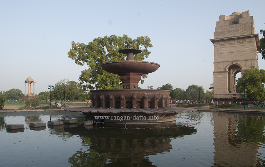 A Fountain, with India Gate (Right) and Canopy (Left)