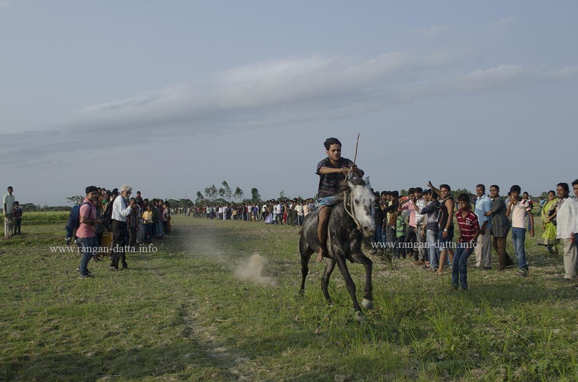 Galloping past cheering crowd, horse race at Jatar Deul
