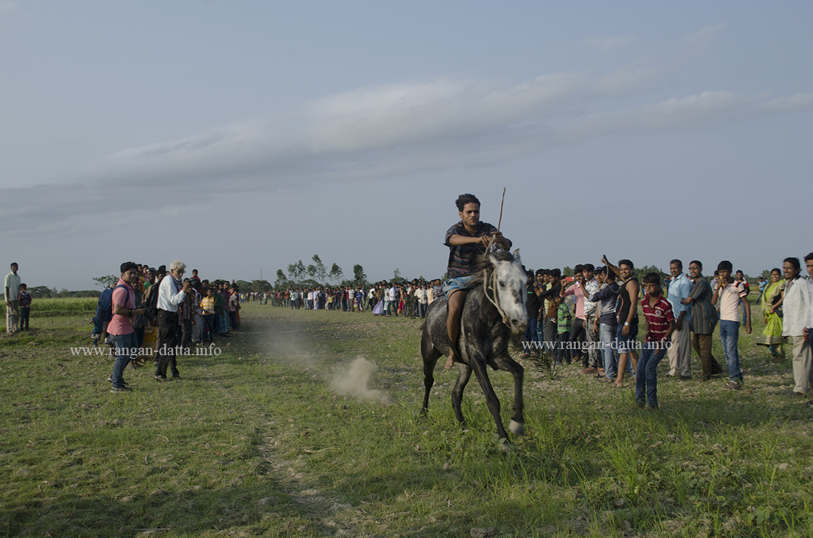 Galloping past cheering crowd, horse race at Jatar Deul