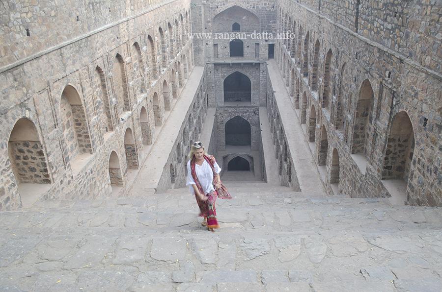 A foreign tourist makes her way up the steps of Agrasen ki Baoli (Ugrasen ki Baoli), Delhi