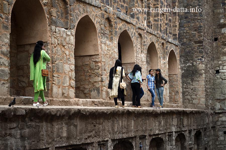 Visitors take a walk along the side ramp of Agrasen ki Baoli, Delhi
