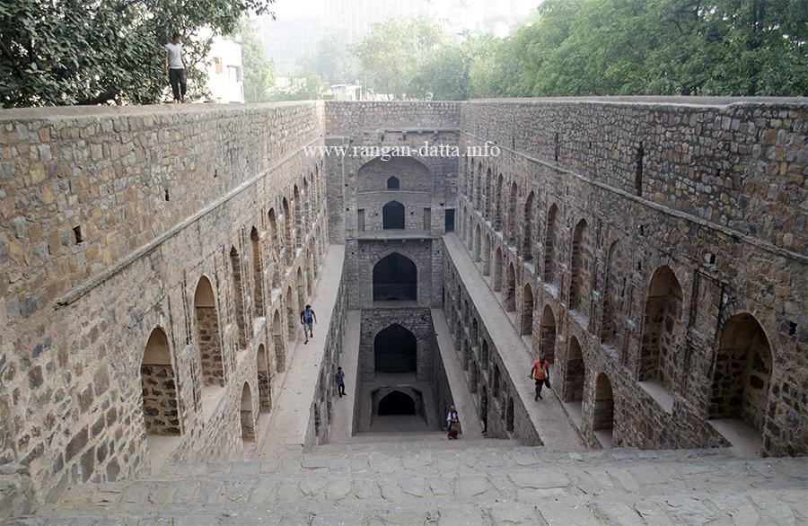 A few scattered tourists admire the beauty of Agrasen ki Baoli, Delhi