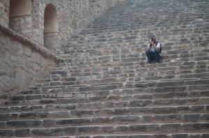 A lone photographer takes aim from the steps of Agrasen ki Baoli, Delhi