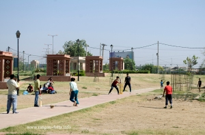 Boys play cricket at CoronationPark, Delhi