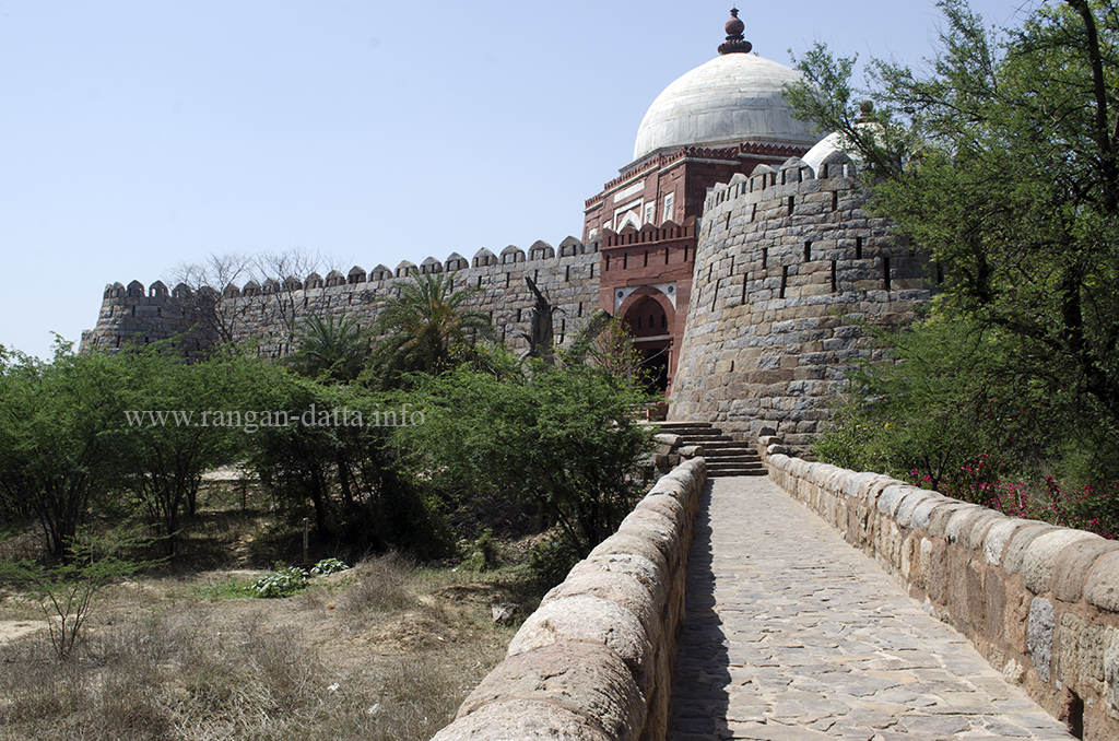 Causeway leading to the gateway of Ghiyas ud - Din Tughluq's Tomb, Delhi