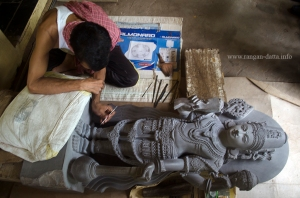 A sculptor gives finishing touches to a Vishnu Statue, Sudarshan Craft Museum