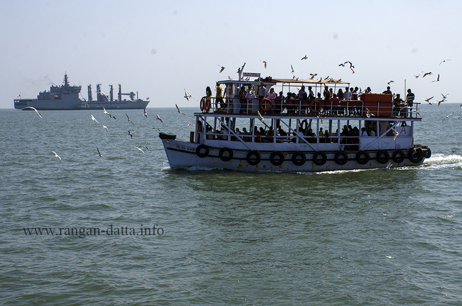 Gulls follow a ferry for food, en route Elephanta Island