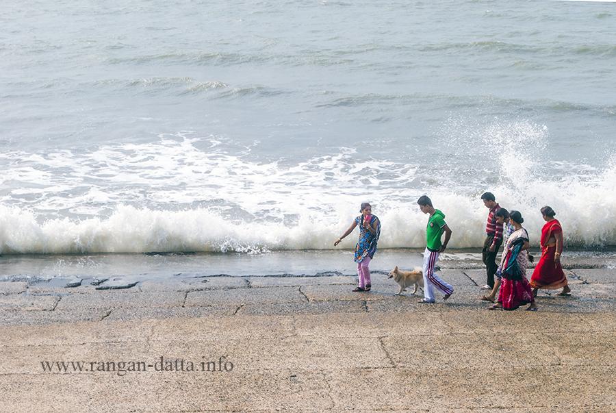 Tourist walk along the Digha sea front